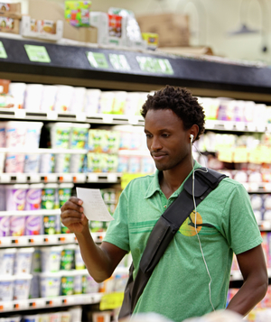 Man in supermarket with earphones