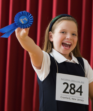 Girl with spelling bee first place ribbon