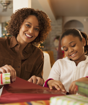 Mother and daughter wrapping gifts