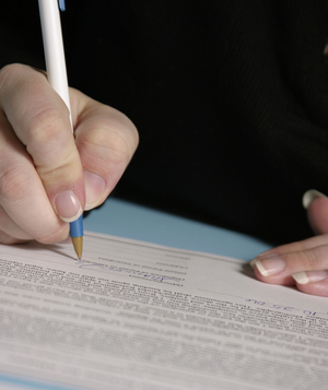 Person signing legal documents