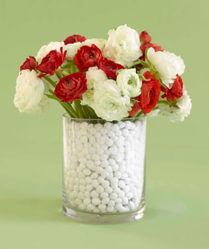 Floral centerpiece with white pom poms