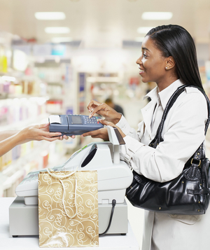 Woman checking out at cash register