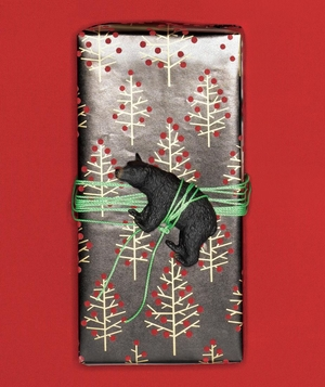 Gift wrapped in holiday paper with toy bear