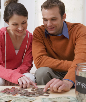Couple counting coins for retirement
