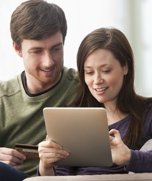 Couple with tablet and credit card