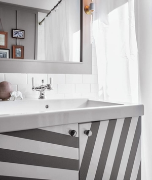 Trompe l'oeil bathroom cabinets with gaffer's tape