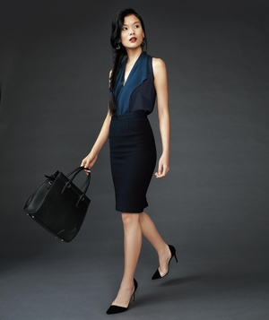 Model in deep navy top and black pencil skirt