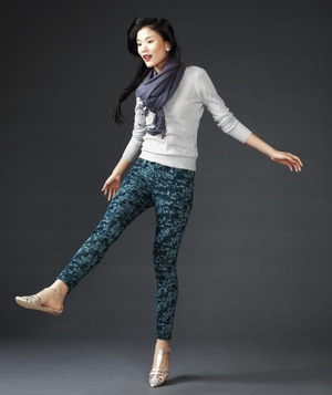 Model in light sweater and floral pants