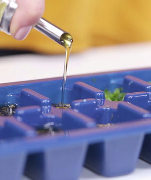 Herbs with olive oil in ice cube tray