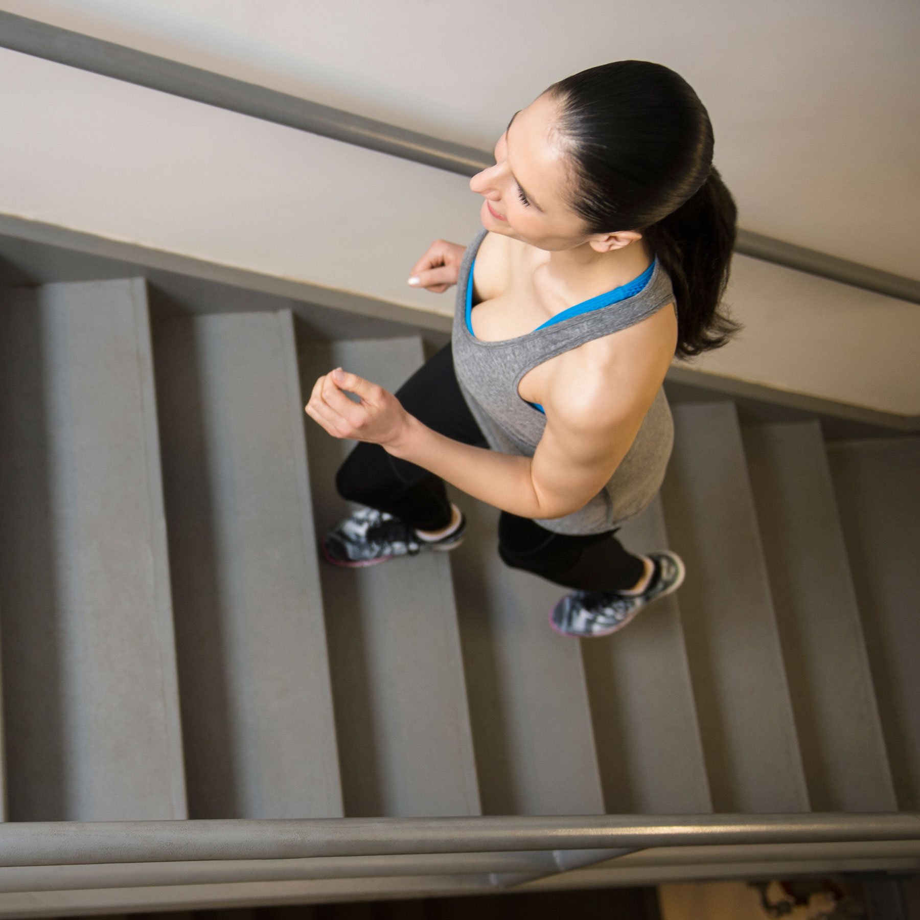 Stairs workout, stair exercises at home - trainer intro/warm-up (woman working out on stairs inside)