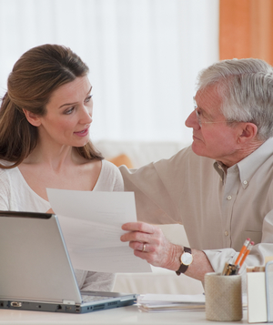 Woman helping father with finances