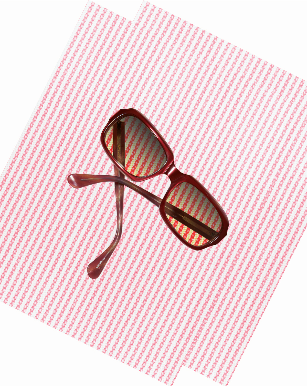 Sunglasses on pink striped background