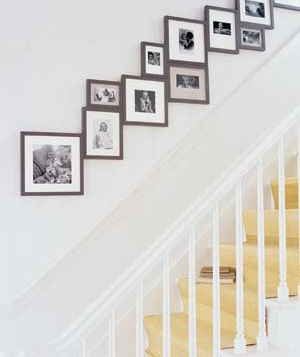 Framed pictures along staircase