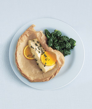 Parchment-Baked Halibut With Sautéed Spinach