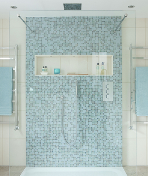 Shower with blue mosaic tile and rainfall showerhead