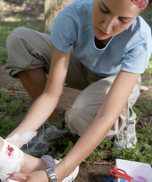 Woman treating ankle wound