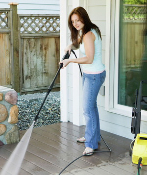 Woman cleaning porch