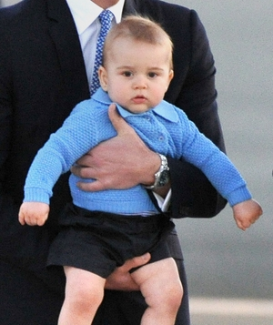 Prince George in blue sweater and shorts