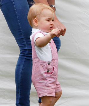 Prince George in striped overalls