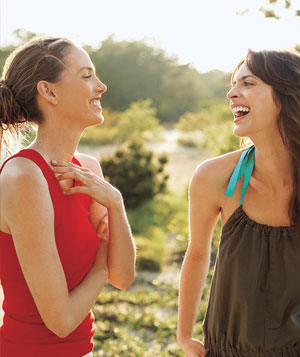 2 models outdoors in countryside laughing