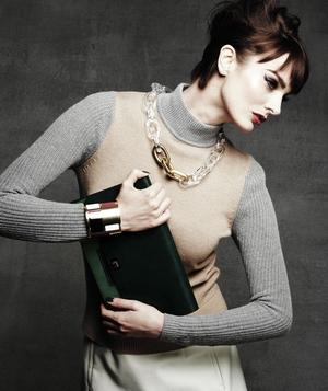 Model wearing turtleneck sweater and bold necklace