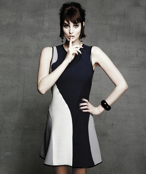 Model wearing bold swirl sheath dress
