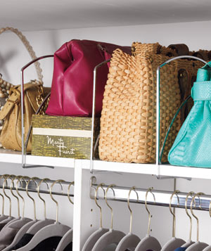 Bags and purses organized in closet with shelf dividers