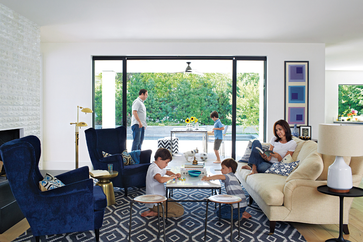 Living room with navy patterned rug and textiles