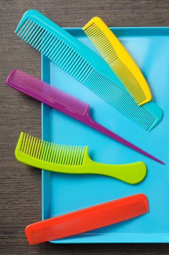 Colorful combs on a blue tray