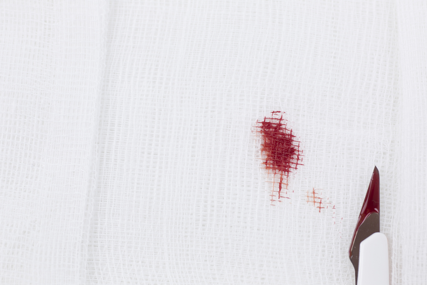 blood stain on white gauze