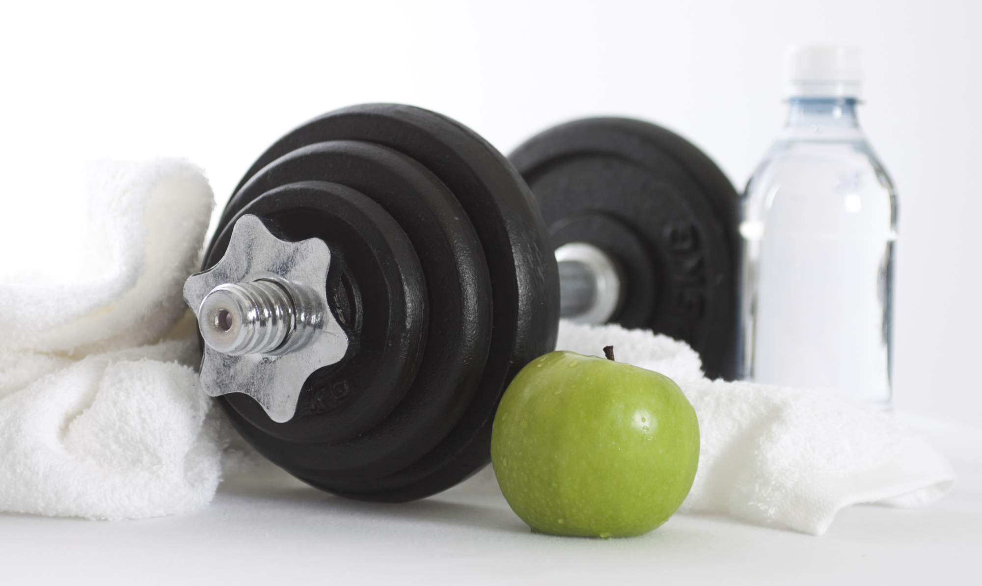 Apple, free weight, water, towel