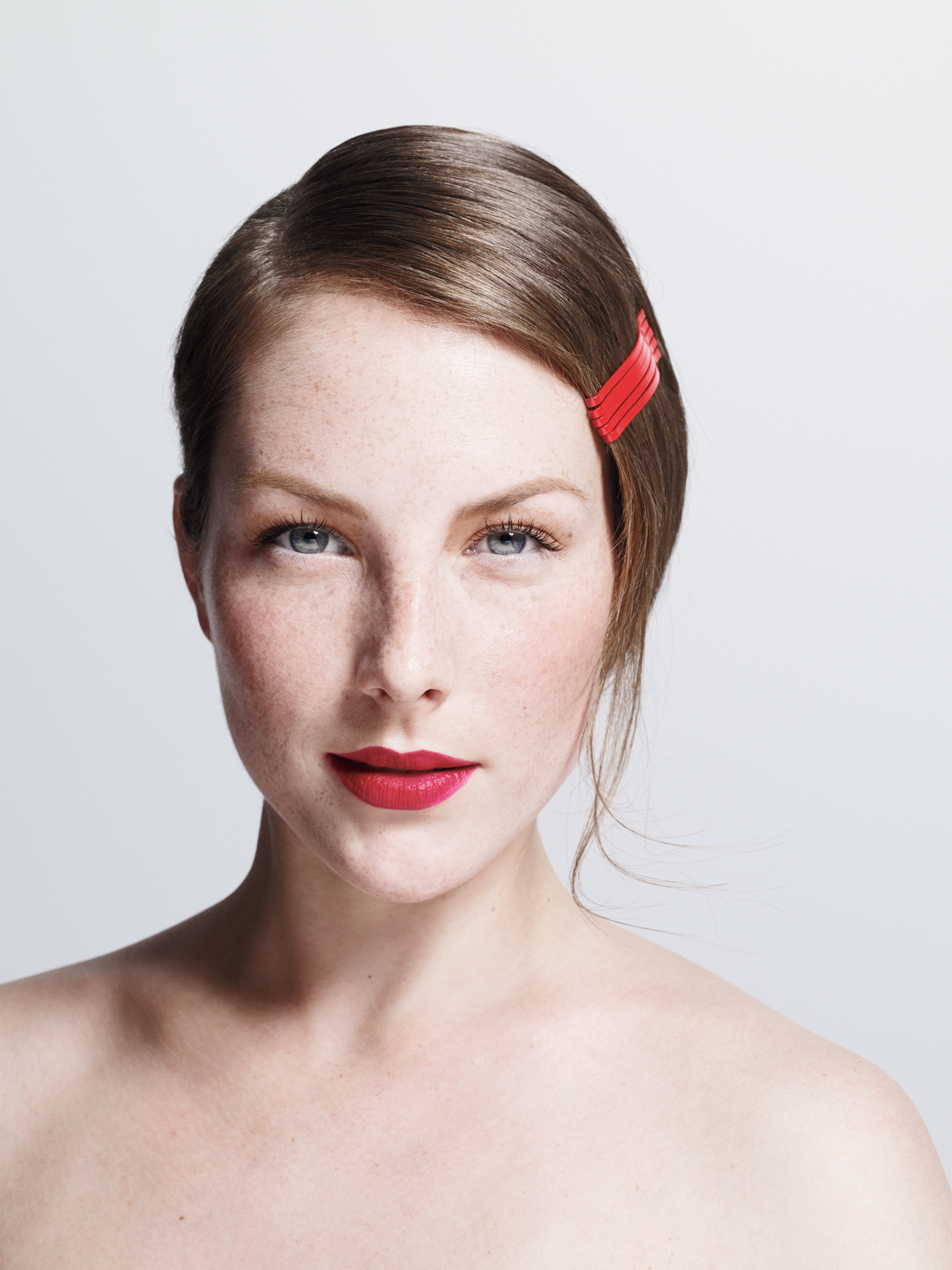 Model with red bobby pins in hair