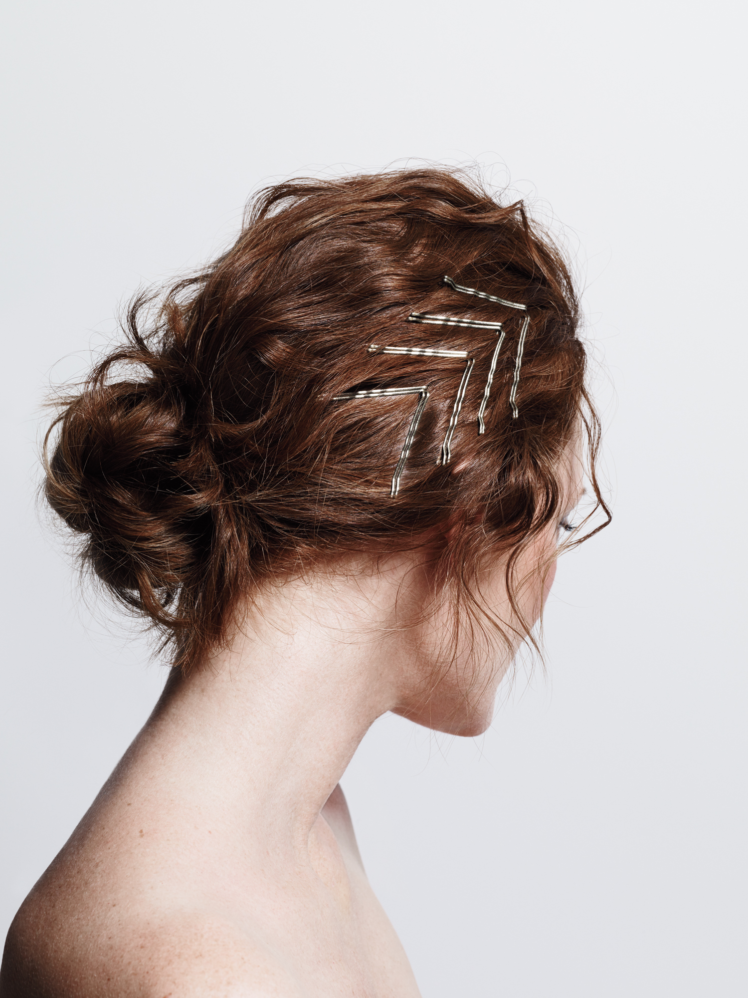 Model with bobby pins in V formation