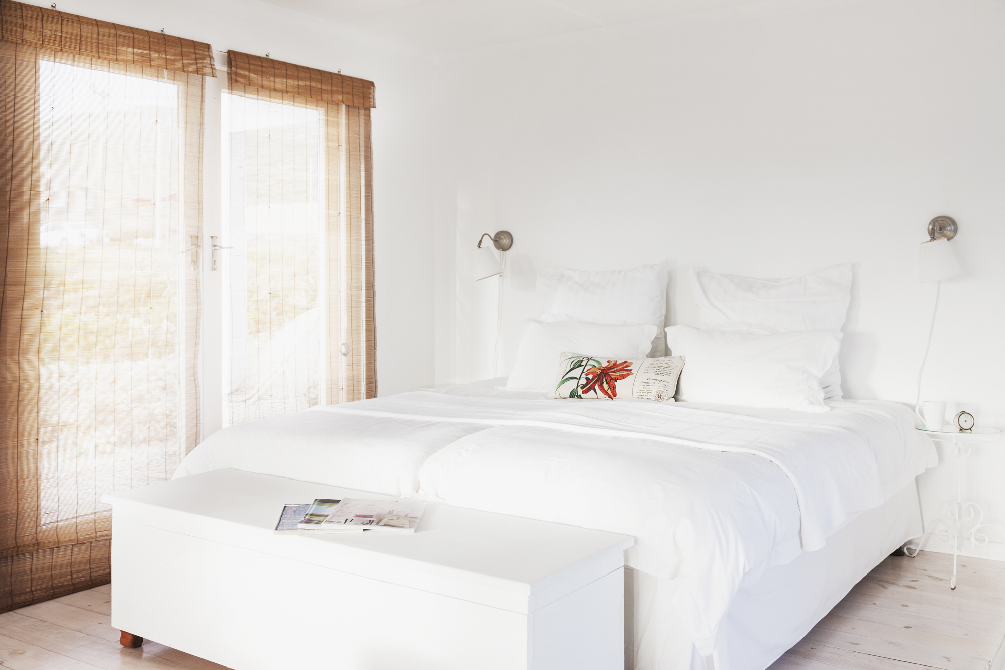 White bedroom with bench