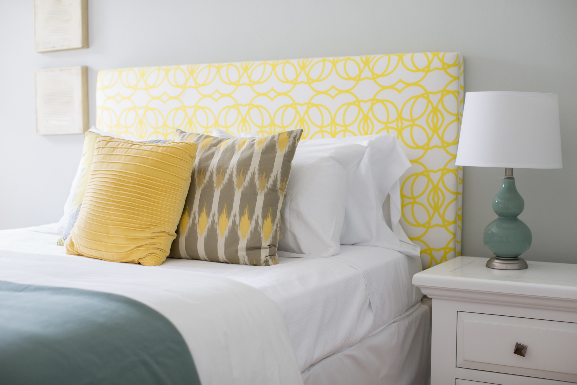 Bed with yellow and white headboard