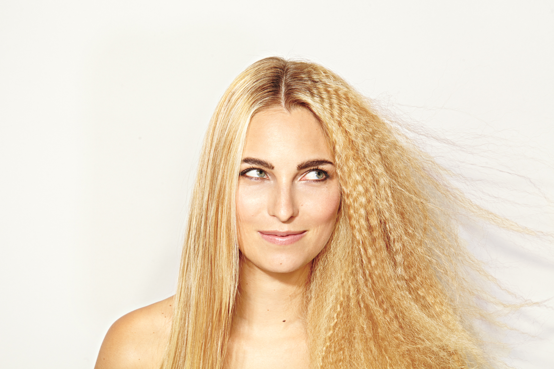 Woman with half head of frizzy staticky hair