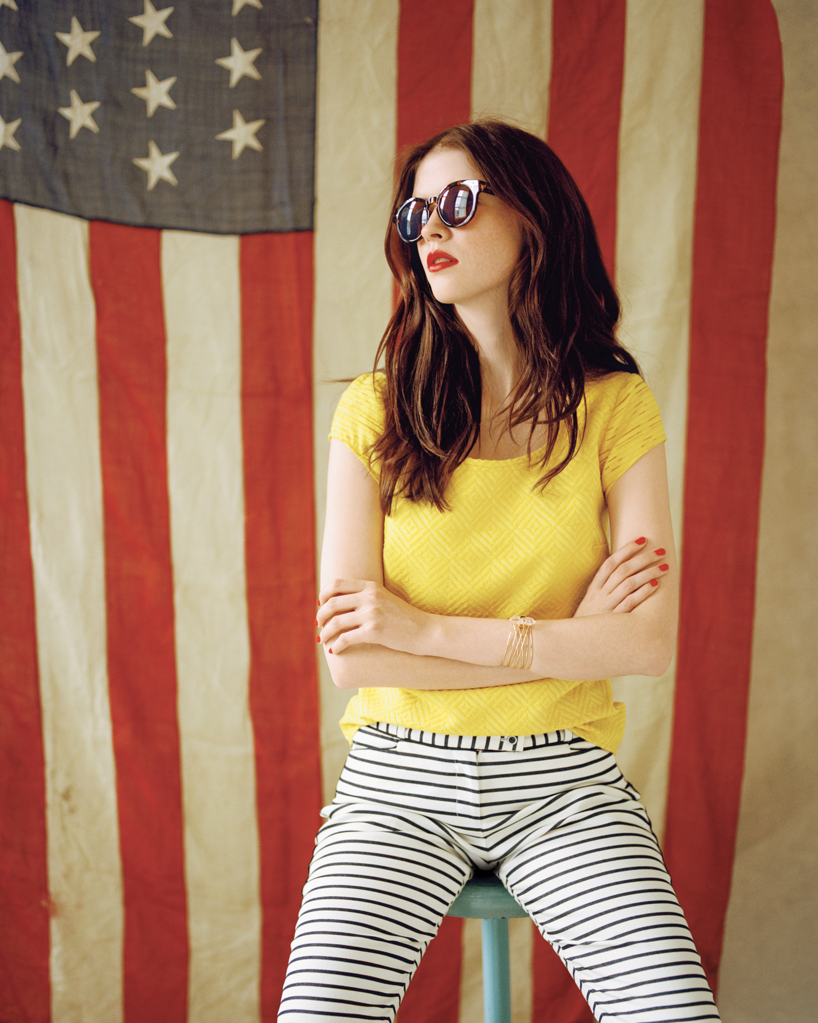 Model wearing yellow tee and striped pants