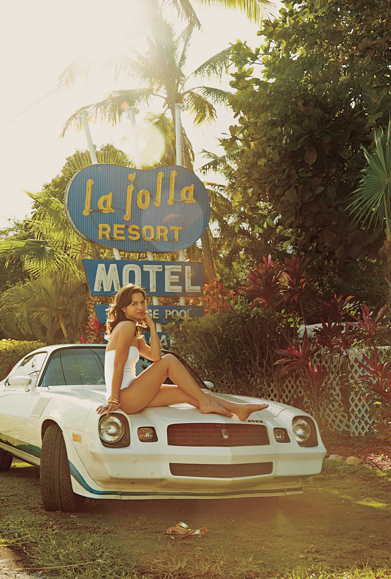 Model in swimsuit on Z28 in front of motel sign