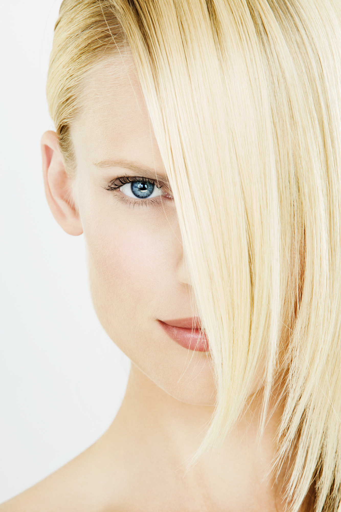 Woman with bleached hair combed over face