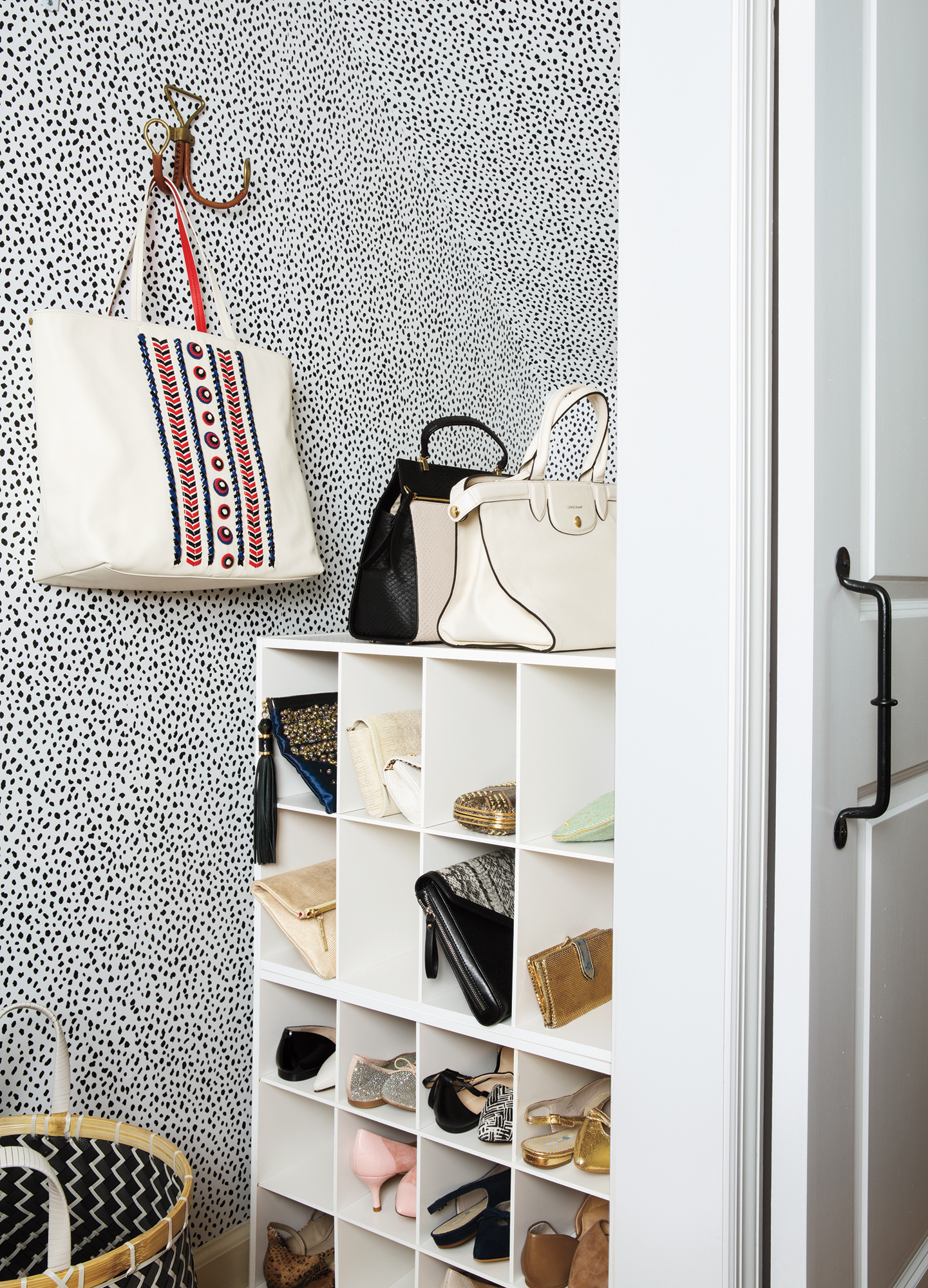 White open shelves with shoes and bags