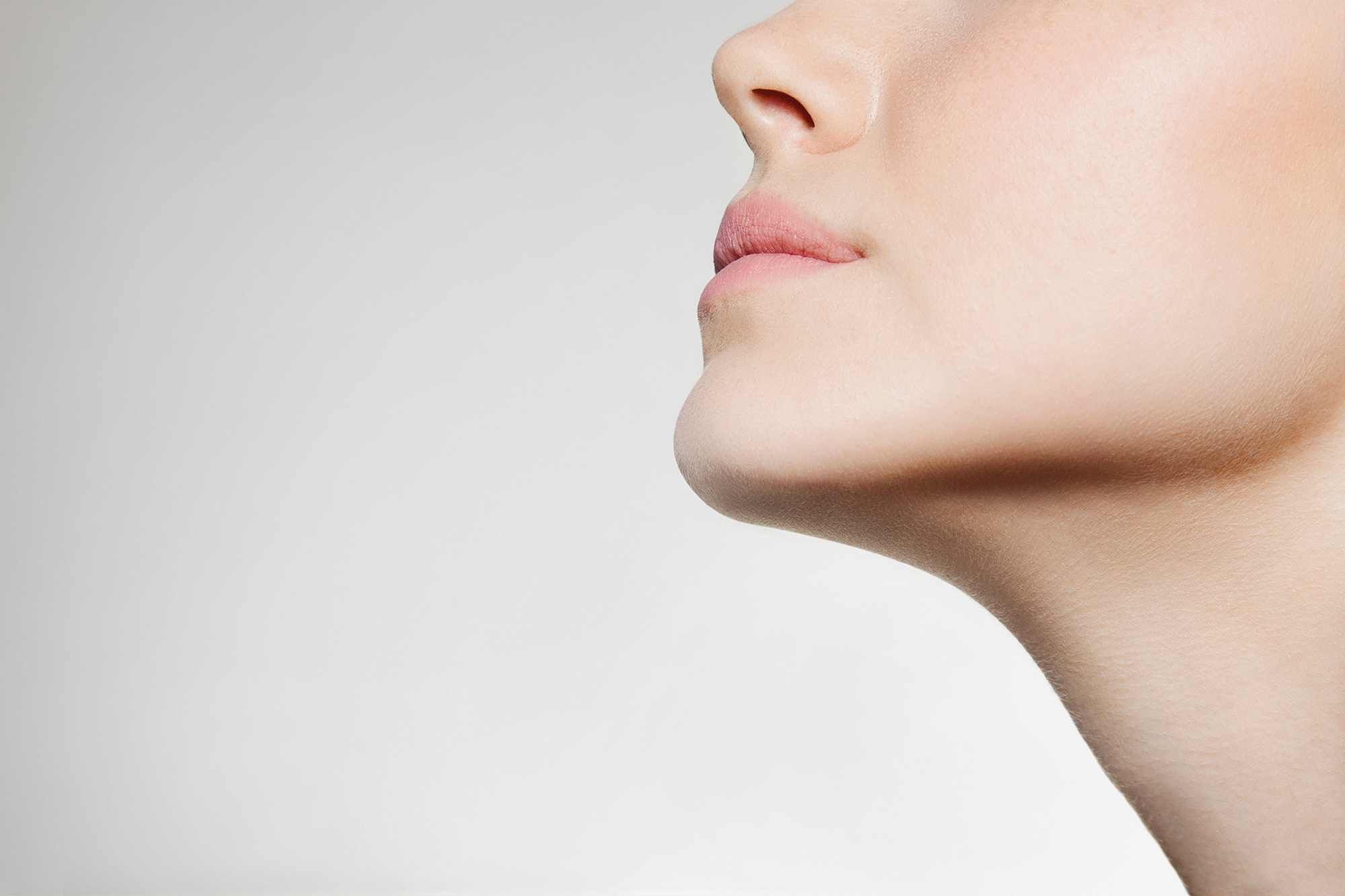 Woman's jawline, neck
