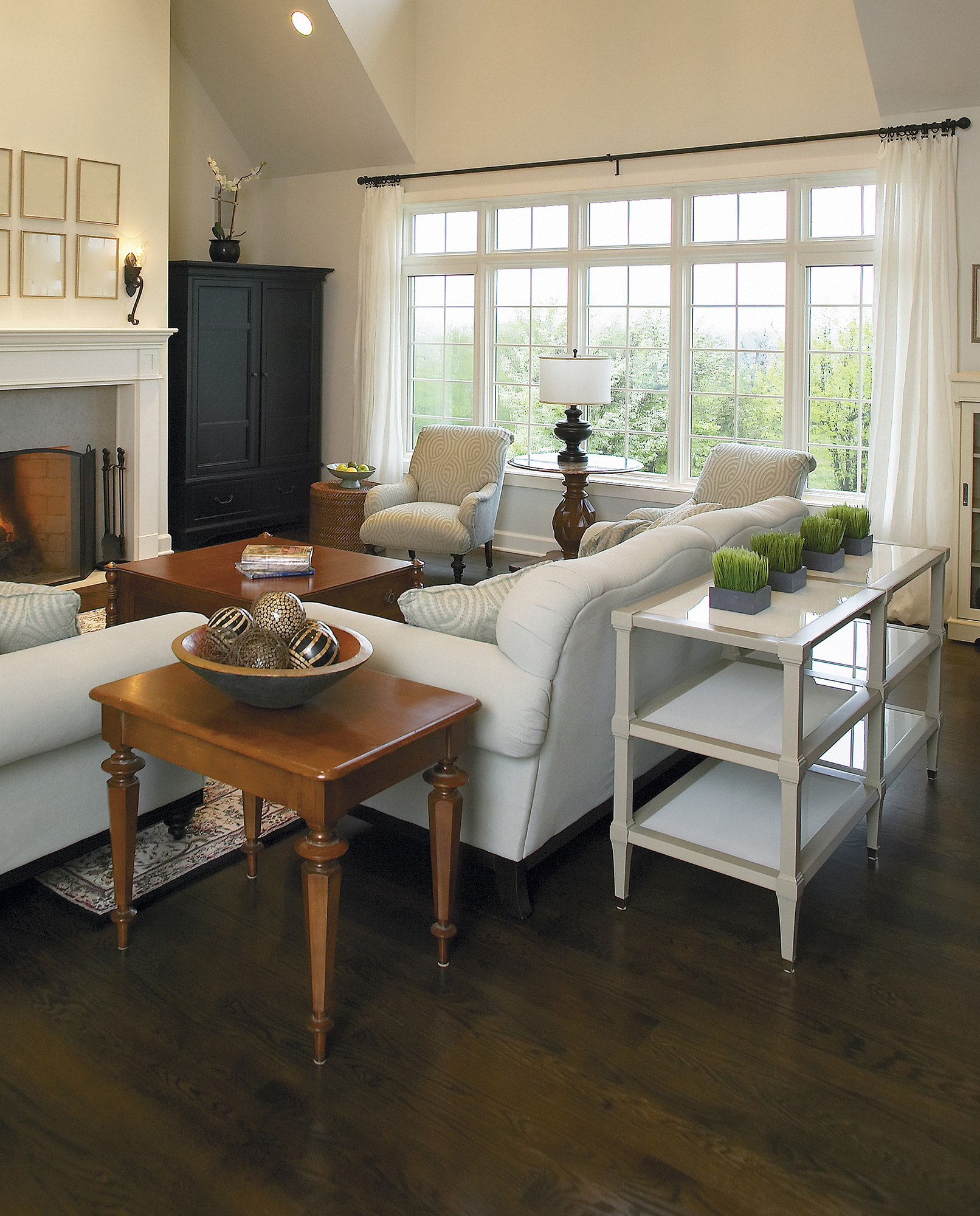 Living room with white accents and wood floors
