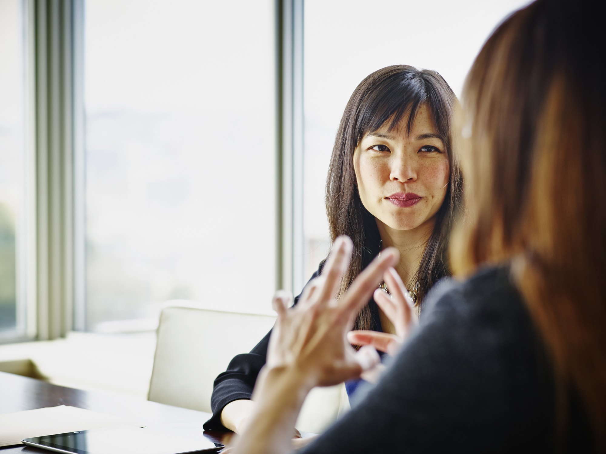 Woman listening to person talking