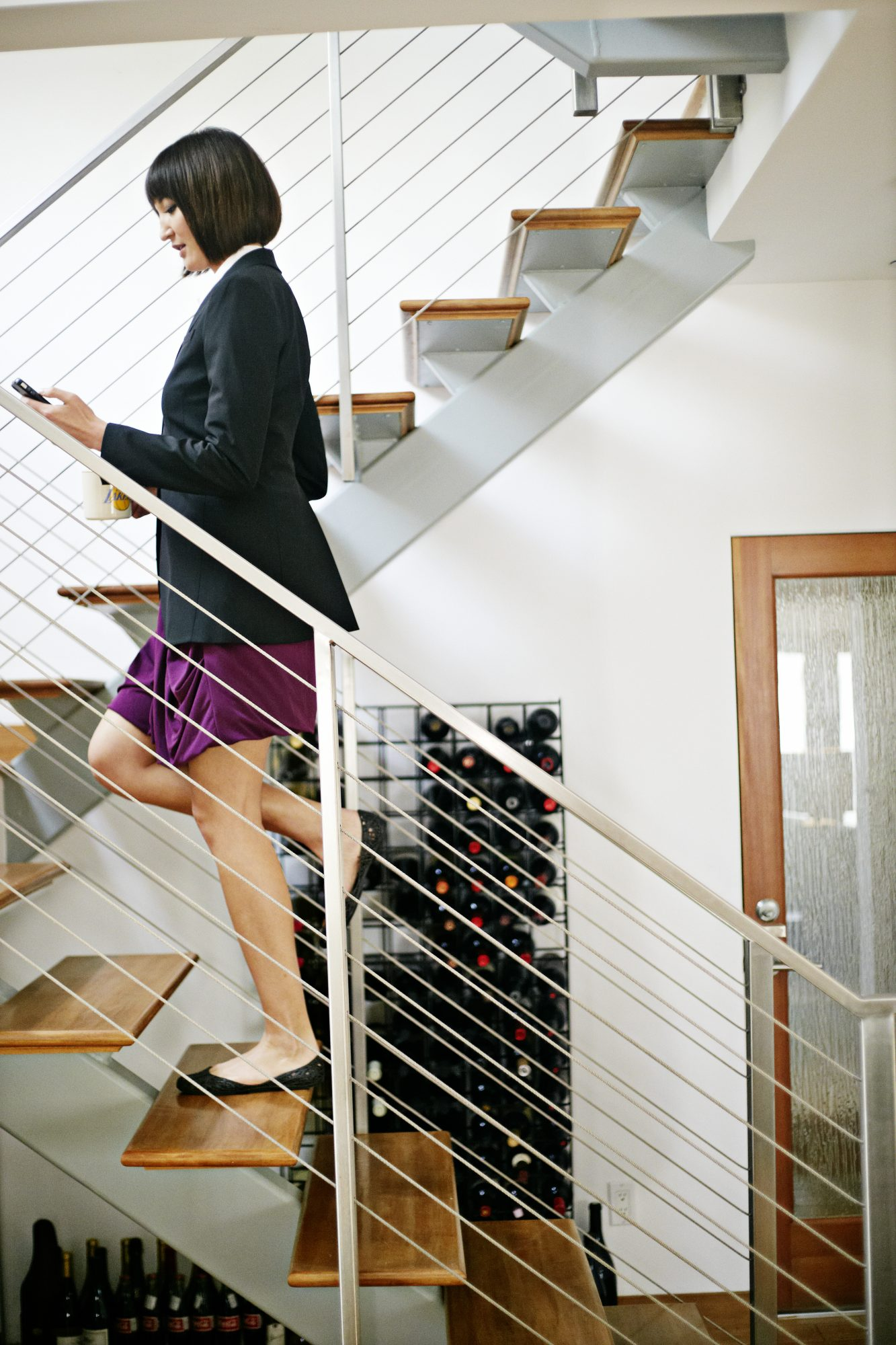 Woman Climbing Stairs Texting