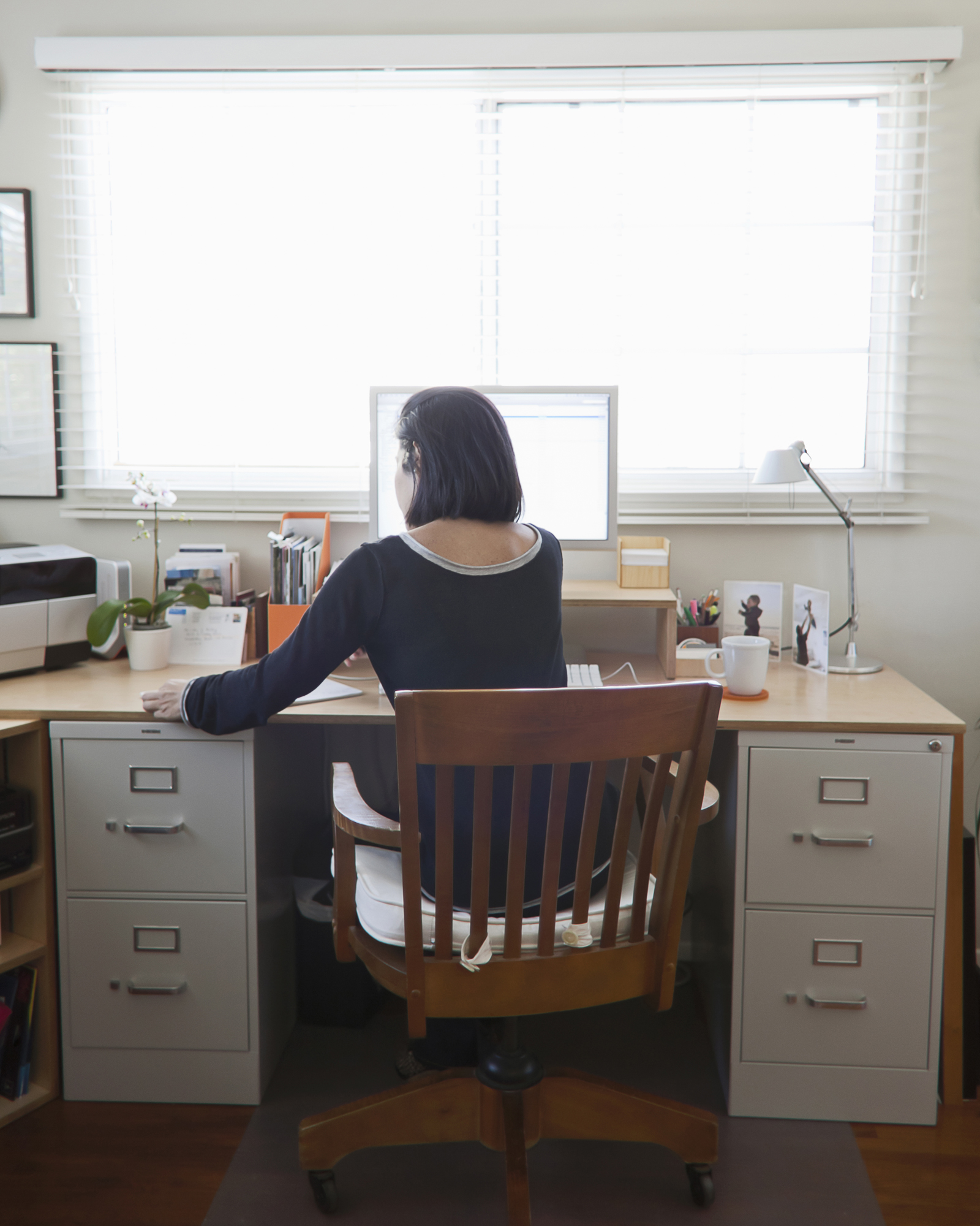 Woman sitting at desk with computer