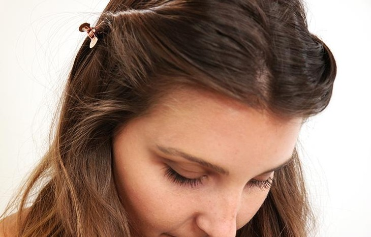 Woman with butterfly clip in her hair.