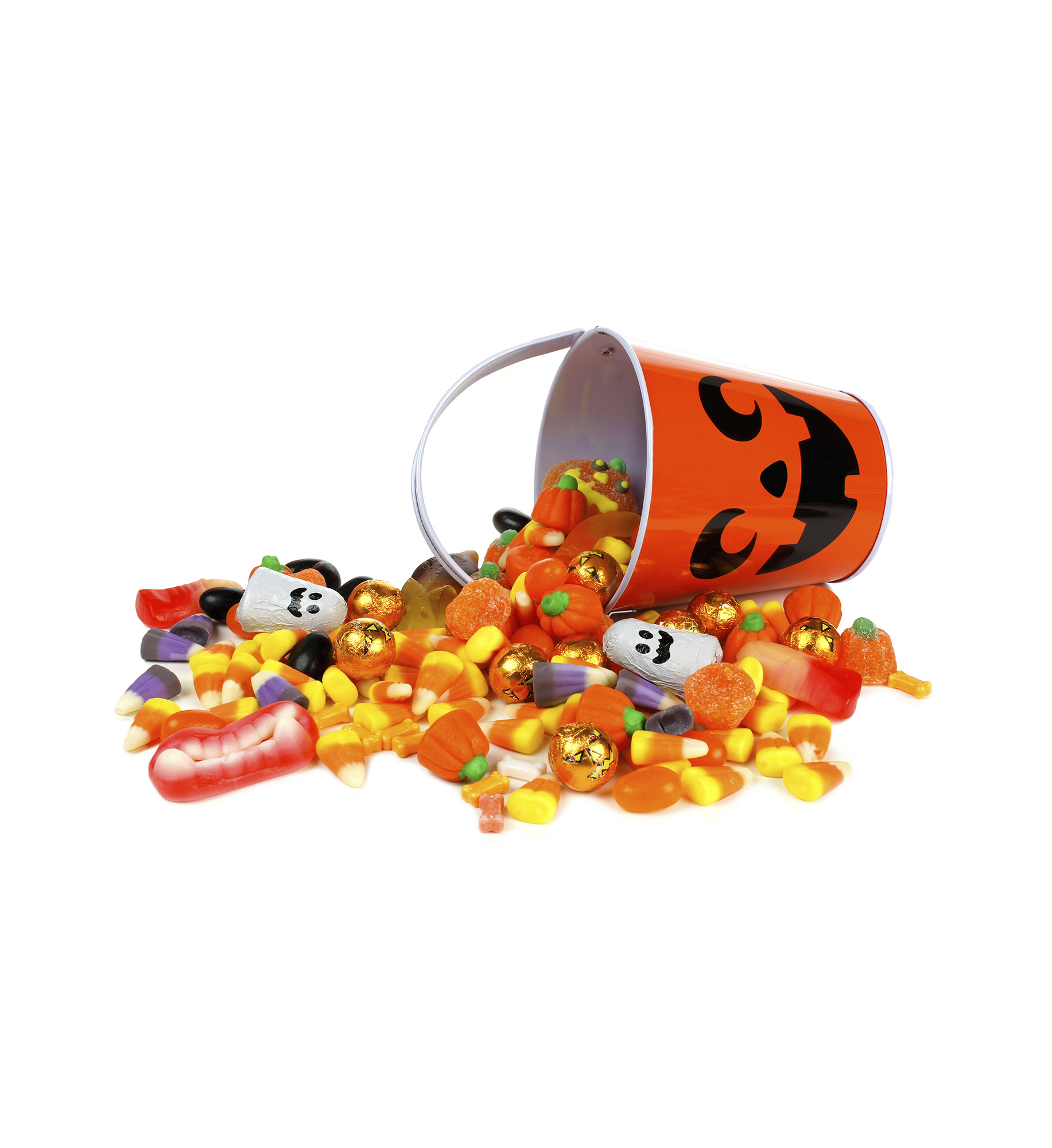 Spilled Halloween candy with Trick-or-Treat bucket