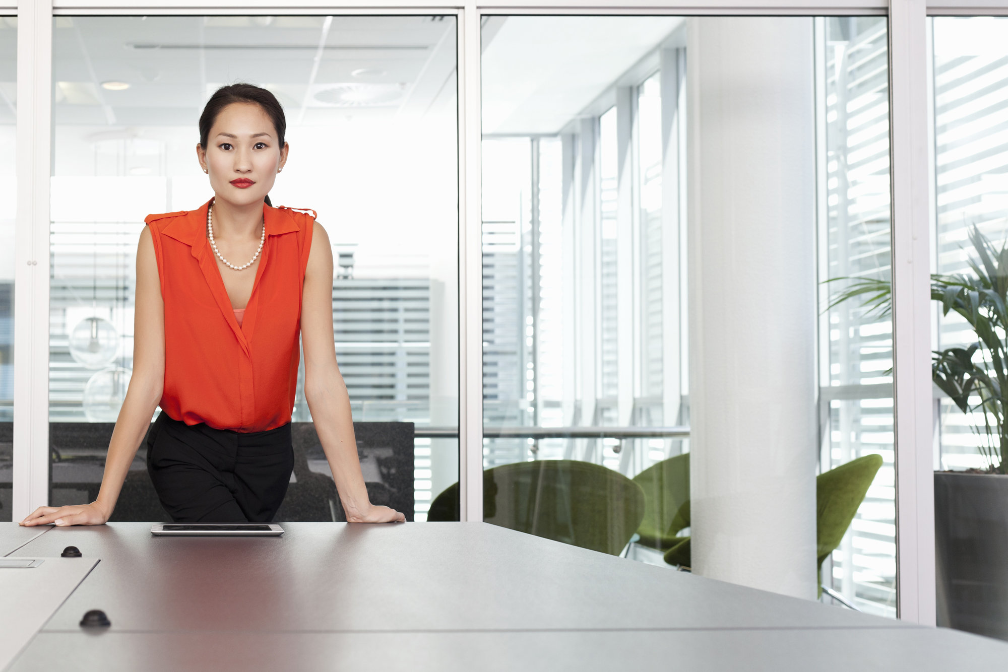 Woman standing at table in office