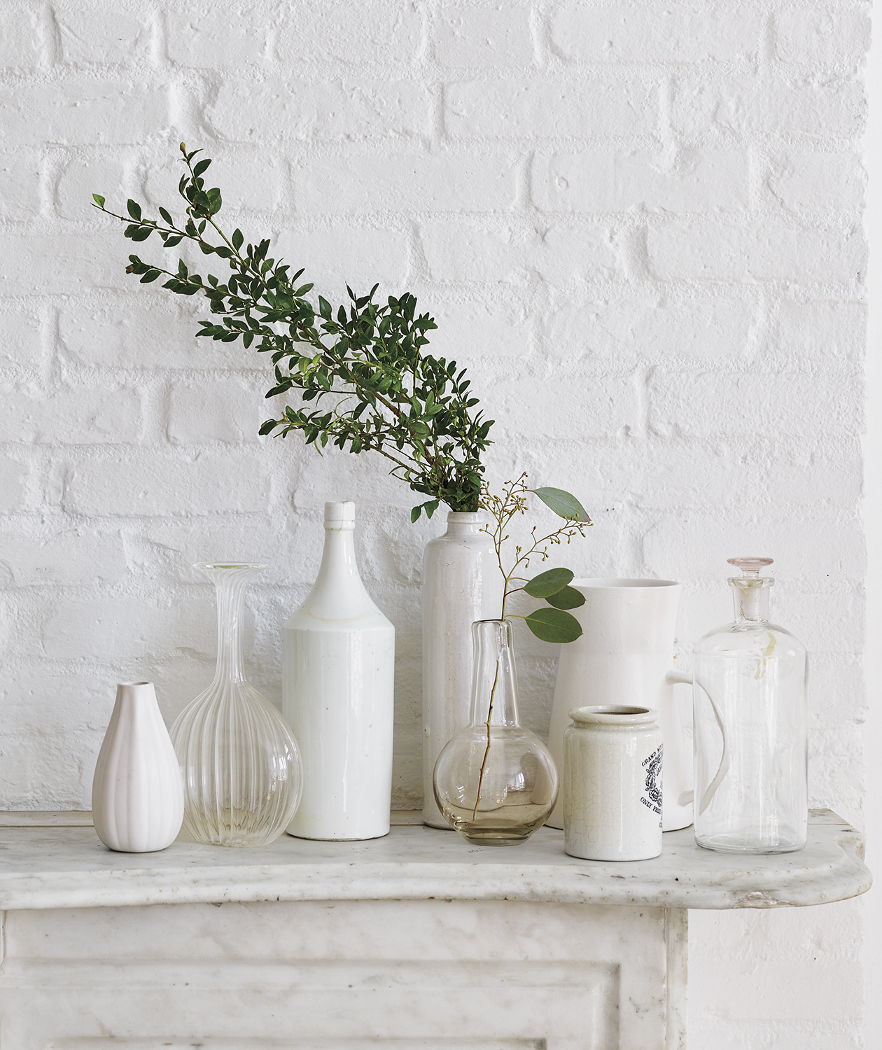 White and clear vases with branches