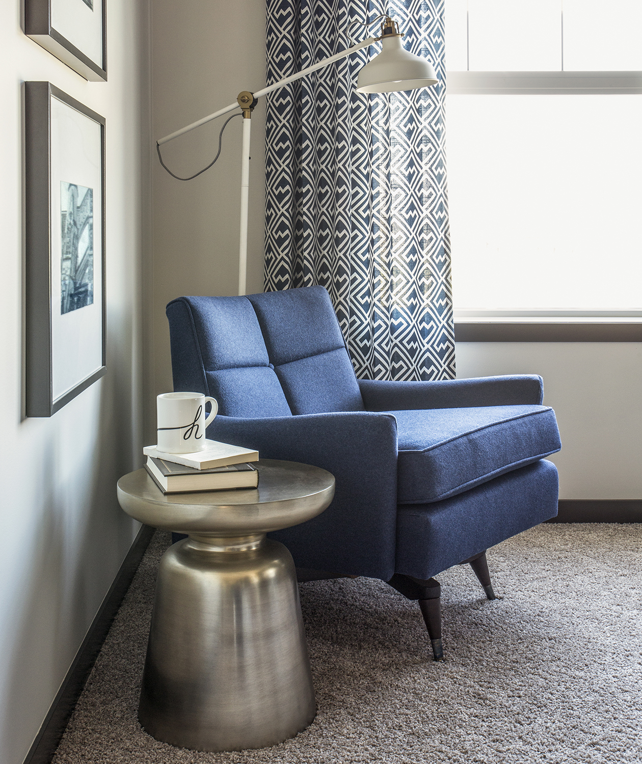Blue armchair and lamp in corner
